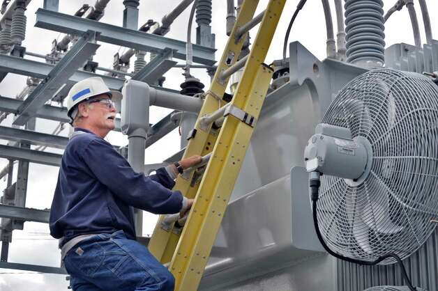 Chief electrician Tom Schener works on the installation of a new 25 MVA transformer at National Grid's new substation rebuilt after Superstorm Sandy Tuesday, Oct. 7, 2014, in Amsterdam, NY.  (John Carl D'Annibale / Times Union) Photo: John Carl D'Annibale / 10028907A