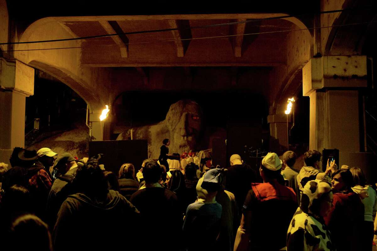 """""""Troll-o-Ween"""" participants gathered under the Aurora Bridge to celebrate the Fremont Troll's 24th birthday bash with live performances and a """"haunting of Fremont"""" walk down 36th Avenue on Friday, Oct. 31, 2014 in Seattle, WA."""
