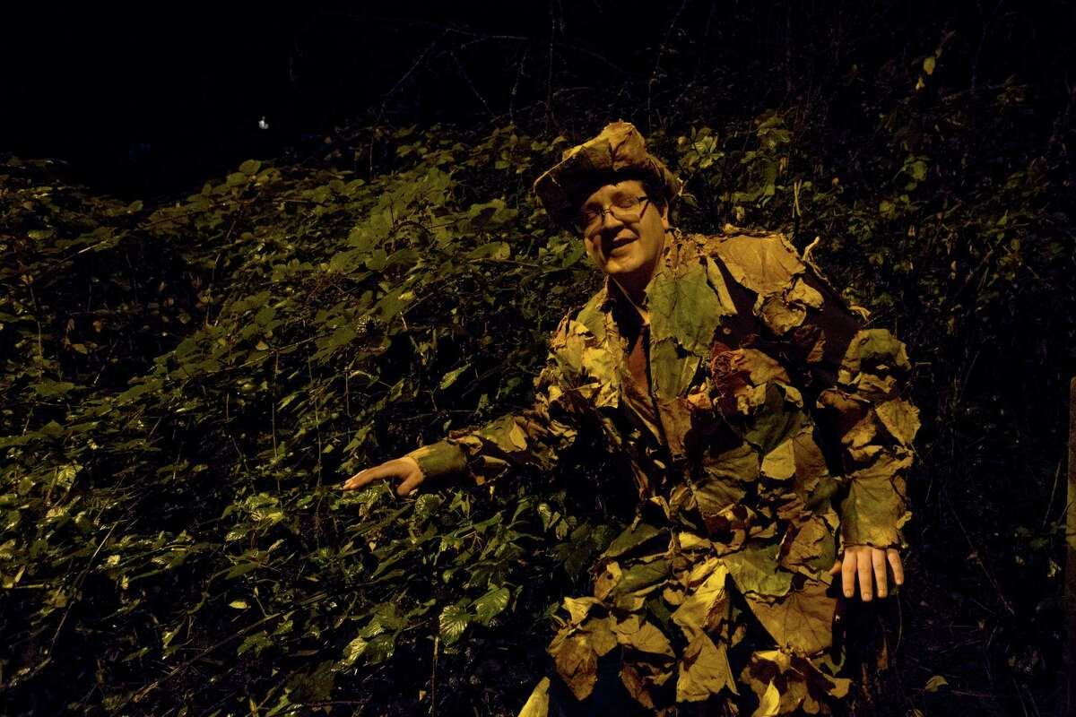 Jeffrey Pierce, 36, camouflages himself into the brush at the annual