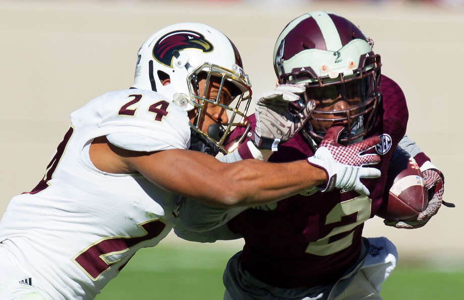 Louisiana Monroe Warhawks cornerback Trey Caldwell pressures Texas A&M Aggies wide receiver Speedy Noil,  during the first half of an NCAA college football game against the Louisiana Monroe Warhawks, at Kyle Field, Saturday, Nov. 1, 2014, in College Station. Photo: Cody Duty, Houston Chronicle / © 2014 Houston Chronicle