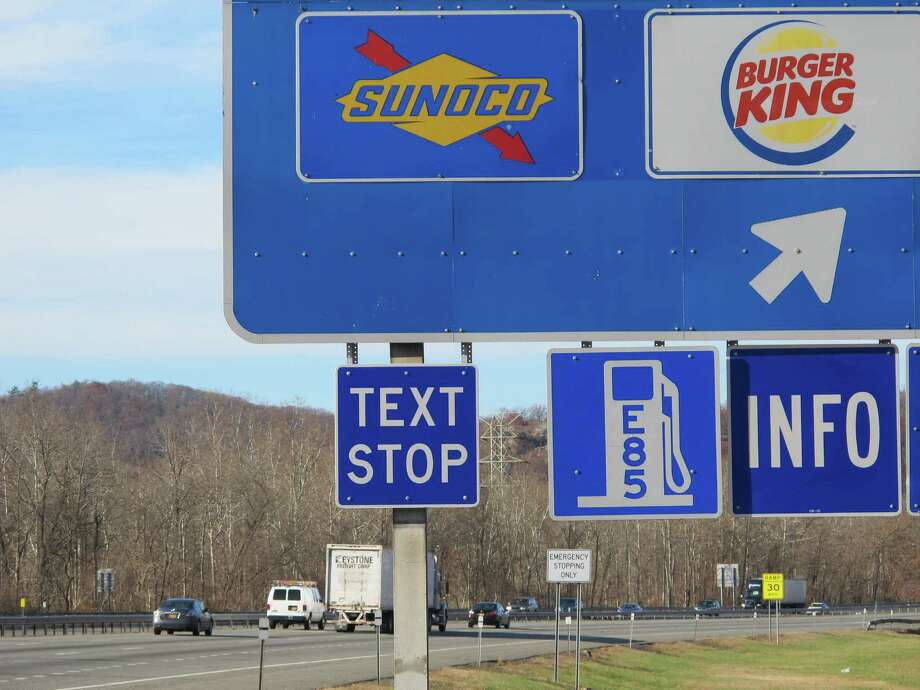 "A new ""text stop"" notification is seen on a sign for a service area on the New York State Thruway in Sloatsburg, N.Y., on Thursday, Nov. 14, 2013. A state crackdown on texting while driving includes designating many pull-off areas as text stops. Photo: Jim Fitzgerald, Jim Fitzgerald / AP / AP"