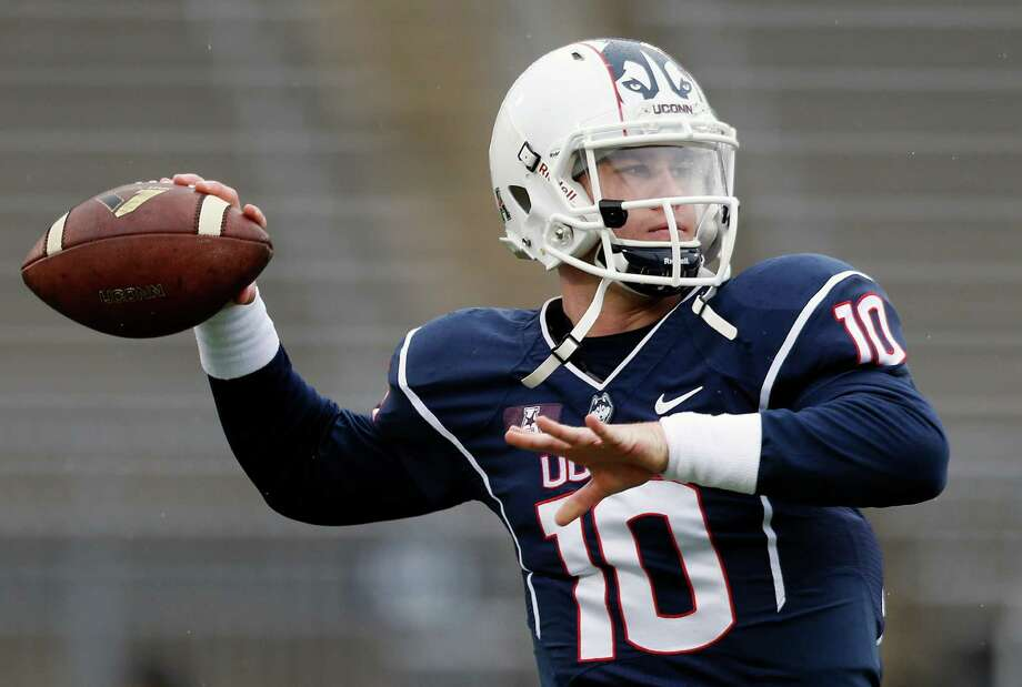 Connecticut quarterback Chandler Whitmer  passes before an NCAA college football team against Central Florida in East Hartford, Conn., Saturday, Nov. 1, 2014. Photo: Michael Dwyer, AP / Associated Press