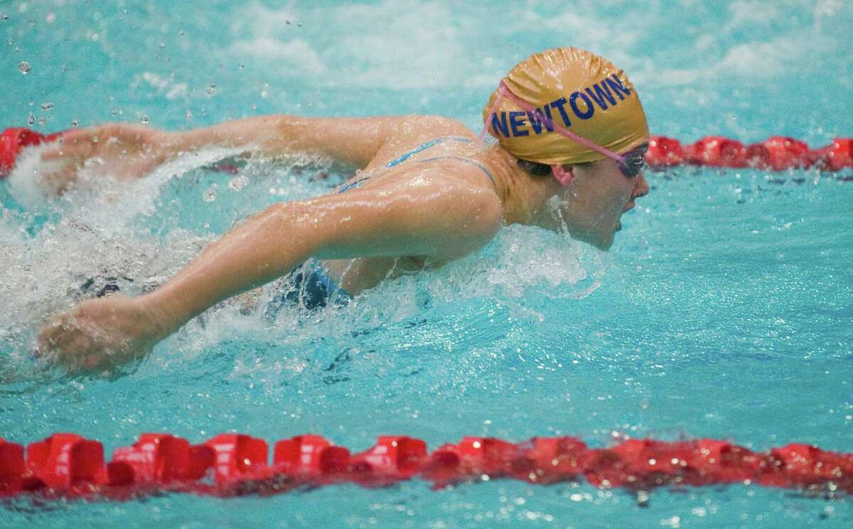 Eliza Eggleston of Newtown High School swimming the breast stroke in the 200 yard Medley Relay at the SWC swimming championships at Masuk High School. Saturday, Nov. 1, 2014