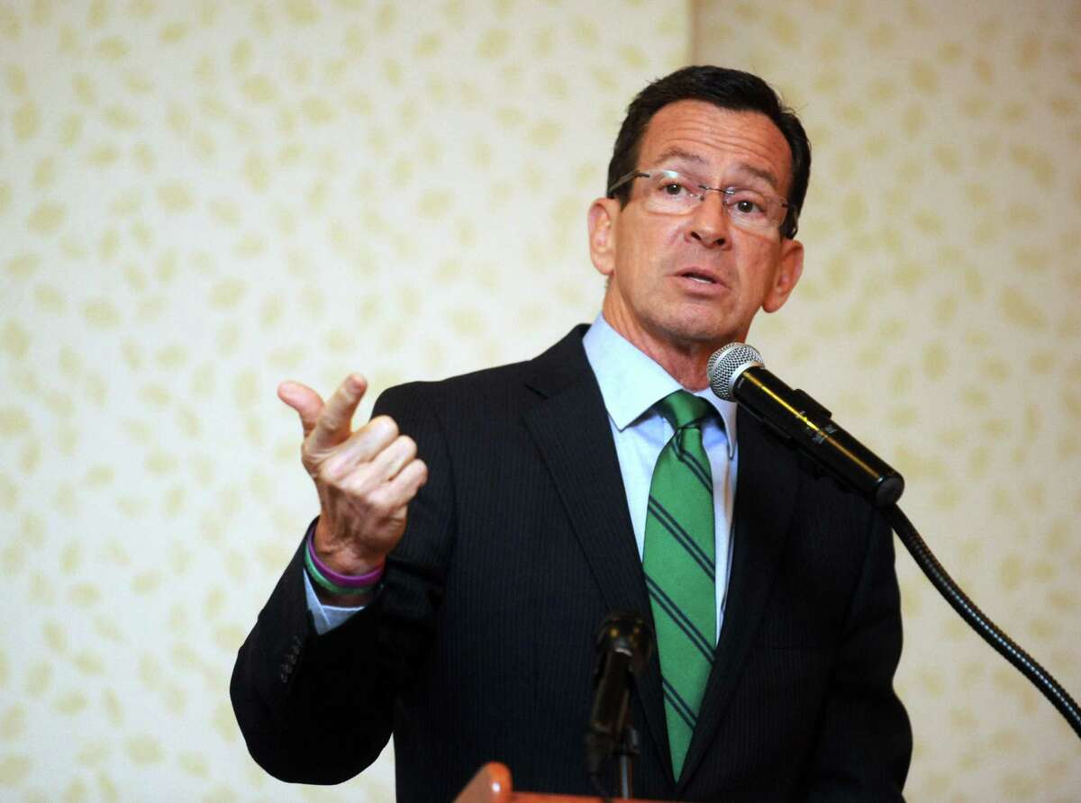 Gov. Dannel P. Malloy speaks Saturday, Nov. 1, 2014, during an NAACP Get Out the Vote rally at the Holiday Inn in Bridgeport, Conn.