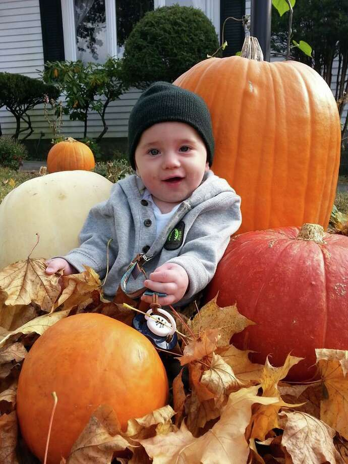 "Parents Ed Barbagallo and Teresa Pandolfo of Colonie write, ""You would never know Edwin Christopher Barbagallo, aka Little E, had open heart surgery a week after birth and spent two months in Boston. Now home with his older sisters Julia, Faith and older brother Nick, he's always smiling and loving the fall."" (Ed Barbagallo)"