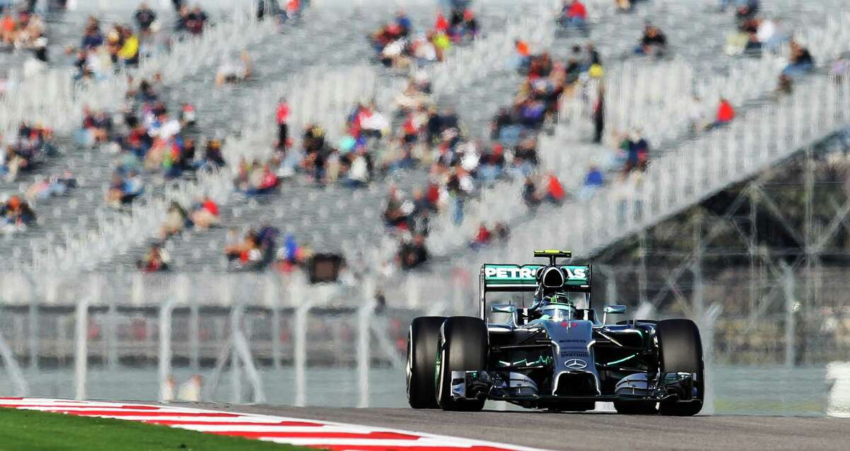 Driver Nico Rosberg of Mercedes AMG Petronas F1 Team heads down the track during the Saturday practice session and qualifying of the 2014 United States Grand Prix at the Circuit of the Americas Saturday, Nov. 1, 2014.