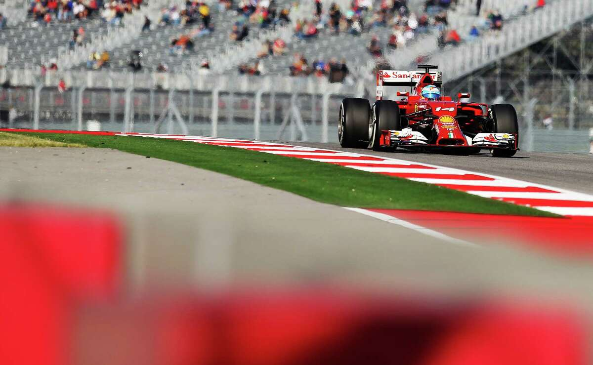 Driver Fernando Alonso of Suderia Ferrari heads down the track during the Saturday practice session and qualifying of the 2014 United States Grand Prix at the Circuit of the Americas Saturday, Nov. 1, 2014. Alonso earned the sixth spot on the grid for Sunday's race.
