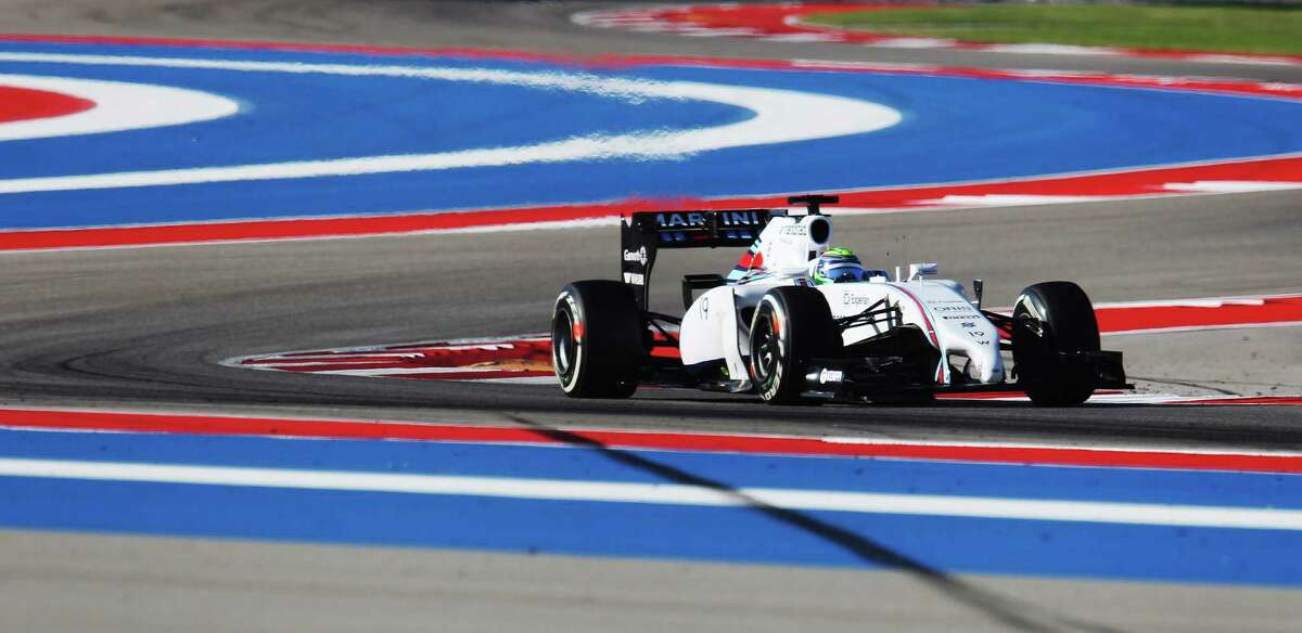 Driver Felipe Massa of Williams Martini Racing goes through a series of corners during the Saturday practice session and qualifying of the 2014 United States Grand Prix at the Circuit of the Americas Saturday, Nov. 1, 2014. Massa earned the fourth position of the grid for Sunday's race.