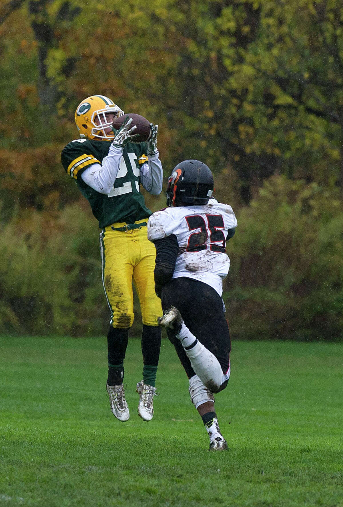 Trinity Catholic's Sam Ruzzi makes a catch for a touchdown during Saturday's football game against Stamford at Trinity Catholic High School on November 1, 2014.