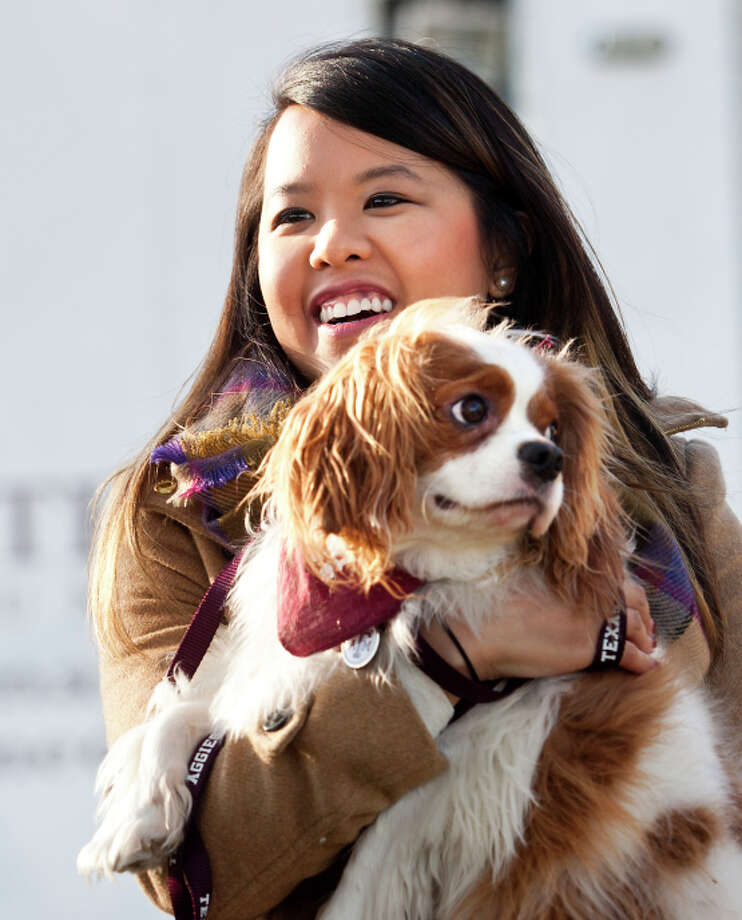 Nina Pham holds Bentley at Hensley Field in Grand Prairie, Texas. Photo: Juan Guajardo / Associated Press / The Fort Worth Star-Telegram