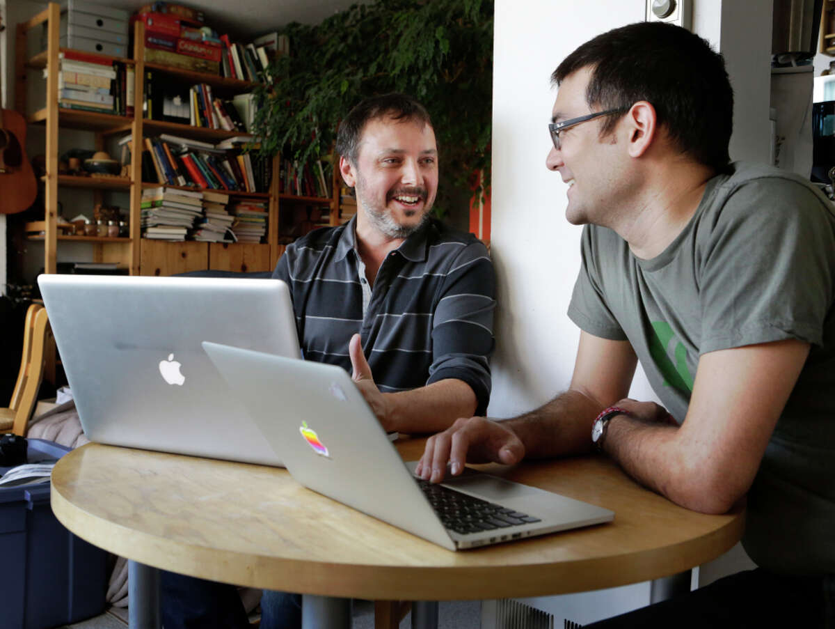 PollVault founder Nolan Love (left) and engineer Tyler Field work in Love's home office in San Francisco .