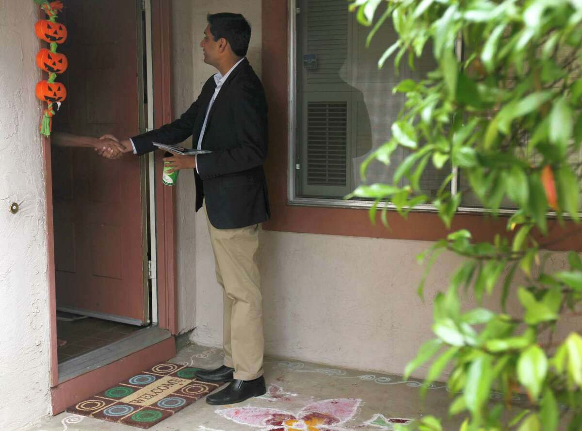 Ro Khanna meets a registered voter while canvassing a neighborhood in Fremont on Nov. 1, 2014. Khanna is seeking to unseat incumbent Rep. Mike Honda in the 17th Congressional District.