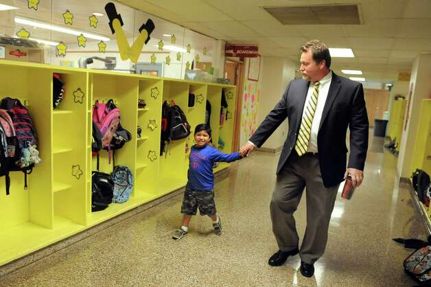 Principal Bill Dollard, right, accompanies Andres Munoz, 4, to an ESL class on Tuesday, Sept. 30, 2014, at Shaker Elementary School in Loudonville, N.Y. (Cindy Schultz / Times Union) Photo: Cindy Schultz / 10028785A