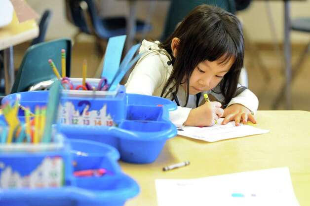 Serena Lin, 5, works on a project in the ESL kindergarten class on Tuesday, Sept. 30, 2014, at Shaker Elementary School in Loudonville, N.Y. (Cindy Schultz / Times Union) Photo: Cindy Schultz / 10028785A