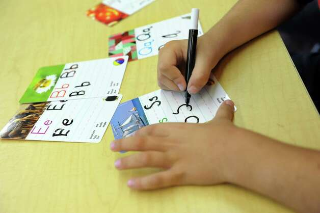 Ari Mohammed, 5, practices writing the English alphabet in the ESL kindergarten class on Tuesday, Sept. 30, 2014, at Shaker Elementary School in Loudonville, N.Y. (Cindy Schultz / Times Union) Photo: Cindy Schultz / 10028785A