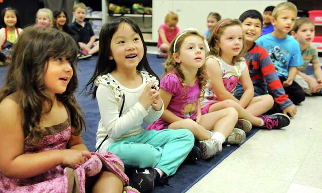 ESL kindergartners sing along as music teacher Erica Doran plays the piano on Tuesday, Sept. 30, 2014, at Shaker Elementary School in Loudonville, N.Y. (Cindy Schultz / Times Union) Photo: Cindy Schultz / 10028785A
