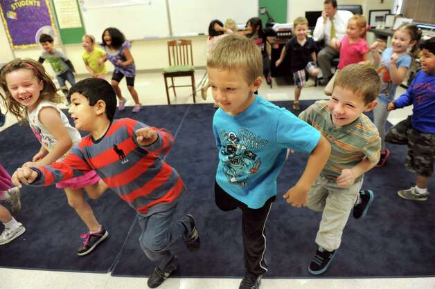 ESL kindergartners hop on one foot as they make up phrases to a song in music class on Tuesday, Sept. 30, 2014, at Shaker Elementary School in Loudonville, N.Y. (Cindy Schultz / Times Union) Photo: Cindy Schultz / 10028785A