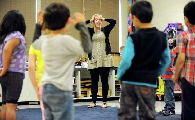 """Music teacher Erica Doran, center, leads  ESL kindergartners in """"Head, Shoulders, Knees and Toes"""" on Tuesday, Sept. 30, 2014, at Shaker Elementary School in Loudonville, N.Y. (Cindy Schultz / Times Union) Photo: Cindy Schultz / 10028785A"""