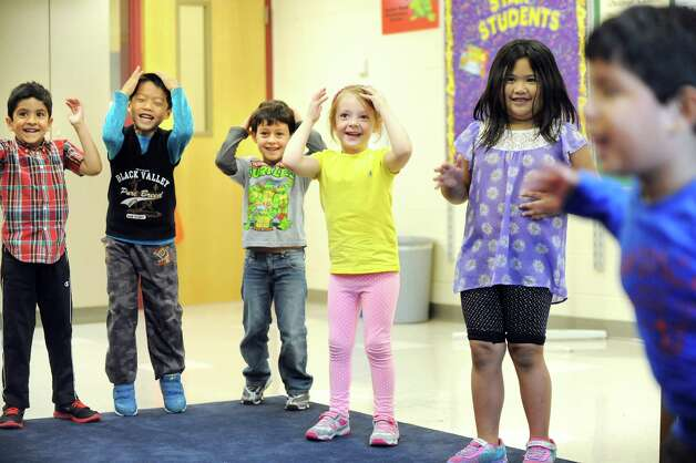 """ESL kindergartners laugh when the tempo speeds up for """"Head, Shoulders, Knees and Toes"""" in music class on Tuesday, Sept. 30, 2014, at Shaker Elementary School in Loudonville, N.Y. (Cindy Schultz / Times Union) Photo: Cindy Schultz / 10028785A"""