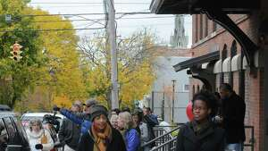 The City and the Arbor Hill Development Corporation hosted a free walking tour showcasing some of the positive new developments in Arbor Hill on Saturday Nov. 1, 2014 in Albany, N.Y. (Michael P. Farrell/Times Union)