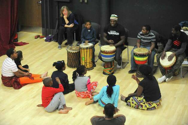 Atito Gohl, center, leads the drum portion of an African dance class taught by members of AhSoEgo Productions and The Barn on Saturday Nov. 1, 2014 in Albany, N.Y. (Michael P. Farrell/Times Union) Photo: Michael P. Farrell / 00029300A