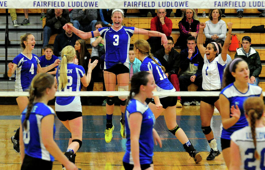 Darien celebrates its win of Fairfield Ludlowe, during FCIAC girls volleyball championship action in Fairfield, Conn. on Saturday, November 1, 2014. Photo: Christian Abraham / Connecticut Post