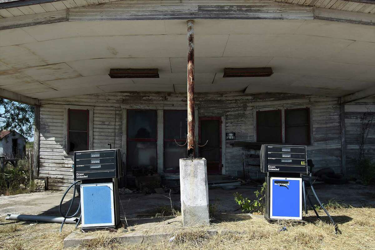 A deserted gas station sits empty near an intersection in Helena, Texas on Saturday, Oct. 25, 2014. Helena was once known for its prominence in the cattle trade but then fell into obscurity. However, the area around Helena is considered some of the most profitable in the Eagle Ford Shale region.