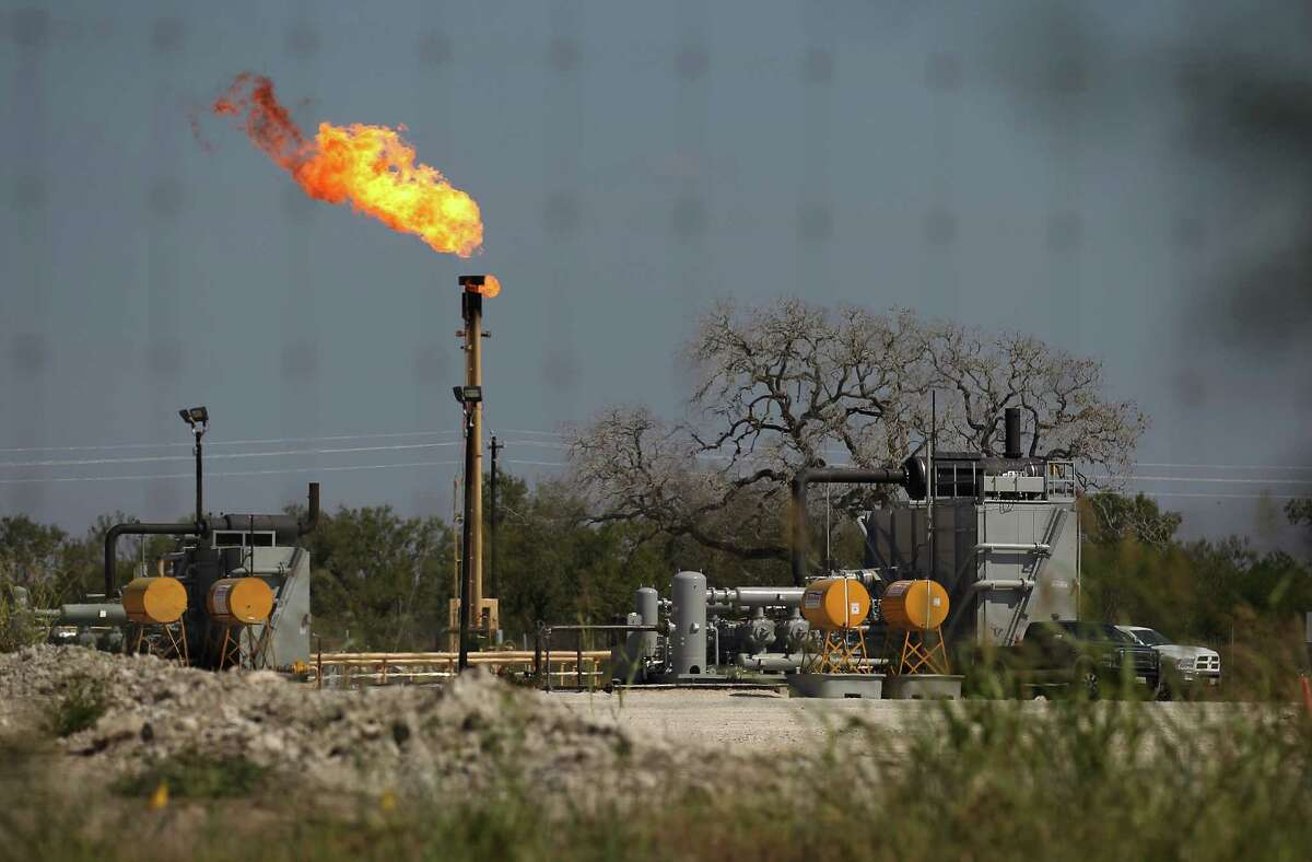 A flare burns near Helena, Texas on Saturday, Oct. 25, 2014. Helena was once known for its prominence in the cattle trade but then fell into obscurity. However, the area around Helena is considered some of the most profitable in the Eagle Ford Shale region.