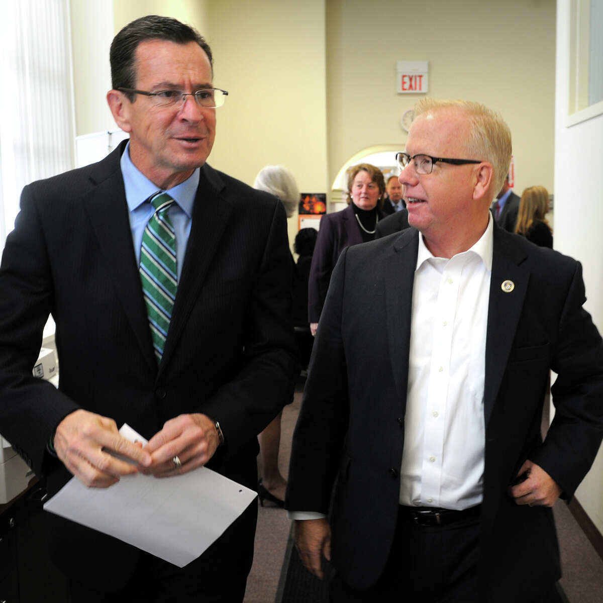 Gov. Dannel Malloy and Danbury Mayor Mark Boughton arrive at a meeting at the Greater Danbury Chamber of Commerce, in Danbury, Conn. Oct. 31, 2014. Praxair Inc. announced they will keep their world headquarters in Danbury, and will invest $65 million to build a new 100,000 square foot corporate facility.