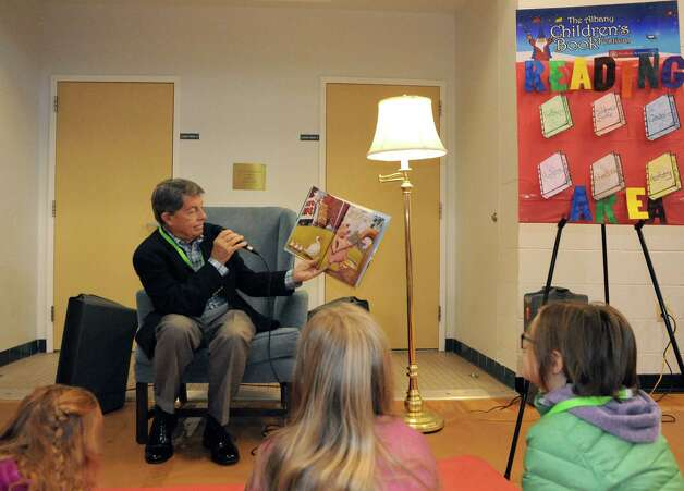 Douglas M. North, head of school of The Albany Academies, reads, The Three Little Pigs and the Somewhat Bad Wolf by Mark Teague, during the Sixth Annual Albany Childrena€™s Book Festival at the Albany Academy for Girls on Saturday Nov. 1, 2014 in Albany, N.Y. (Michael P. Farrell/Times Union) Photo: Michael P. Farrell / 00029289A