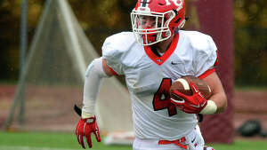 New Canaan's Frank Cognetta carries the ball, during football action against St. Joseph in Trumbull, Conn. on Saturday, November 1, 2014.