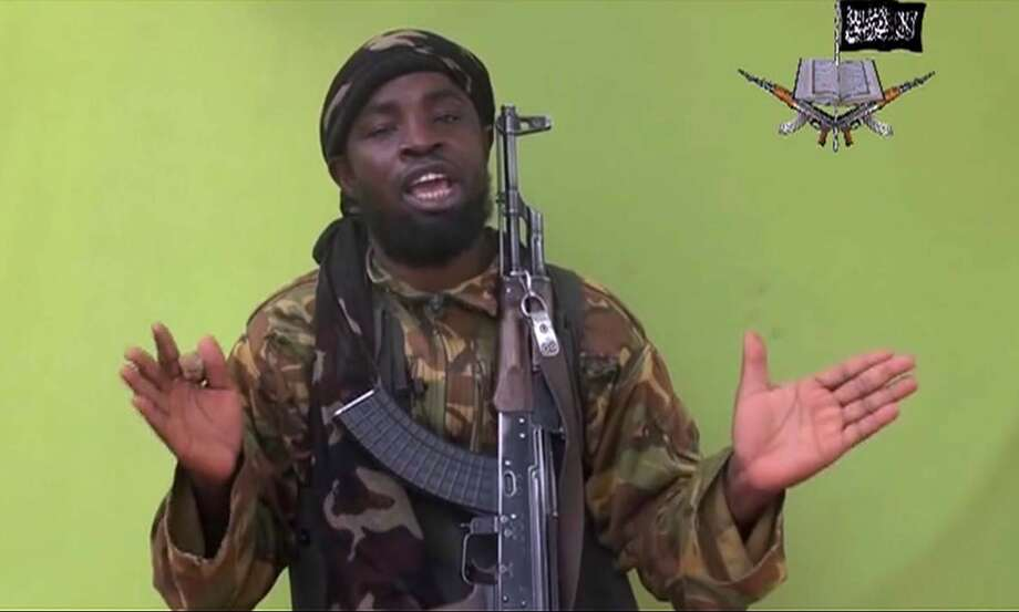 "FILE - In this May 12, 2014 file image from video by Nigeria's Boko Haram terrorist network shows their leader Abubakar Shekau speaks to the camera. The leader of Nigeria's Islamic extremist group Boko Haram denied agreeing to any cease-fire with the government and said more than 200 kidnapped schoolgirls all have converted to Islam and been married off. In a new video released late Friday, Oct. 31, 2014, Abubakar Shekau dashed hopes for a prisoner exchange to get the girls released. ""The issue of the girls is long forgotten because I have long ago married them off,"" he said, laughing. ""In this war, there is no going back."" (AP Photo/File) Photo: TEL / Militant Video"