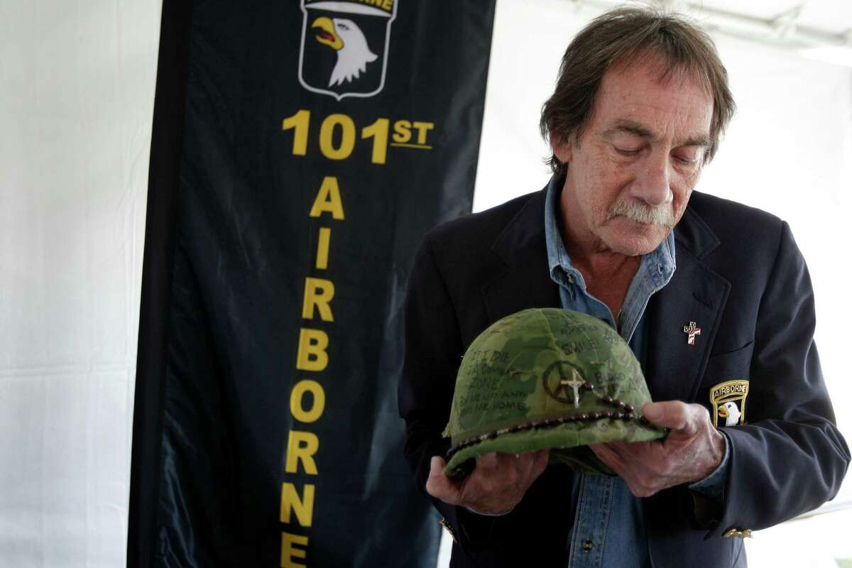 Veteran Bryan Smothers holds the helmet he used in Vietnam in the Legends and Heroes Tent who share stories at Wings Over Houston 2014 at Ellington Field on Saturday, Nov. 1, 2014, in Houston.