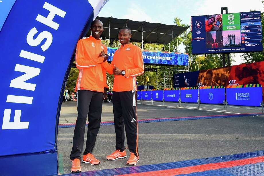 NEW YORK, NY - OCTOBER 30:  Wilson Kipsang (L) poses for a picture with Geoffrey Mutai (R) at the TCS New York City Marathon finish line on October 30, 2014 in New York City.  (Photo by Alex Goodlett/Getty Images for adidas) ORG XMIT: 519496055 Photo: Alex Goodlett / 2014 Getty Images