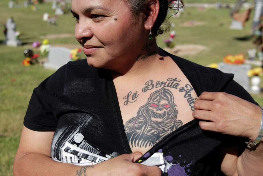 And I don't have a tattoo of La Santa Muerte. Photo: Mayra Beltran, Houston Chronicle / © 2014 Houston Chronicle
