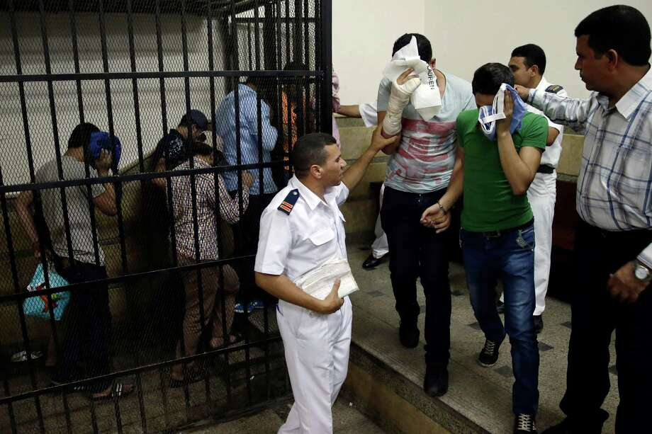 """Eight Egyptian men were convicted Saturday for """"inciting debauchery"""" following their appearance in a video of an alleged same-sex wedding party on a Nile boat. Photo: Hassan Ammar, STF / AP"""