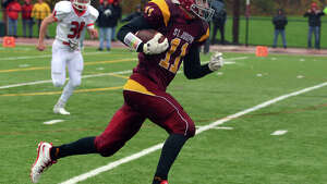 Football action between new Canaan and St. Joseph in Trumbull, Conn. on Saturday, November 1, 2014.