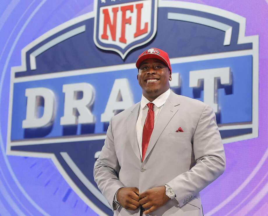 USC center Marcus Martin poses for photos after being selected as the 70th pick by the San Francisco 49ers in the third round of the 2014 NFL Draft, Friday, May 9, 2014, in New York. (AP Photo/Jason DeCrow) Photo: Jason DeCrow, ASSOCIATED PRESS