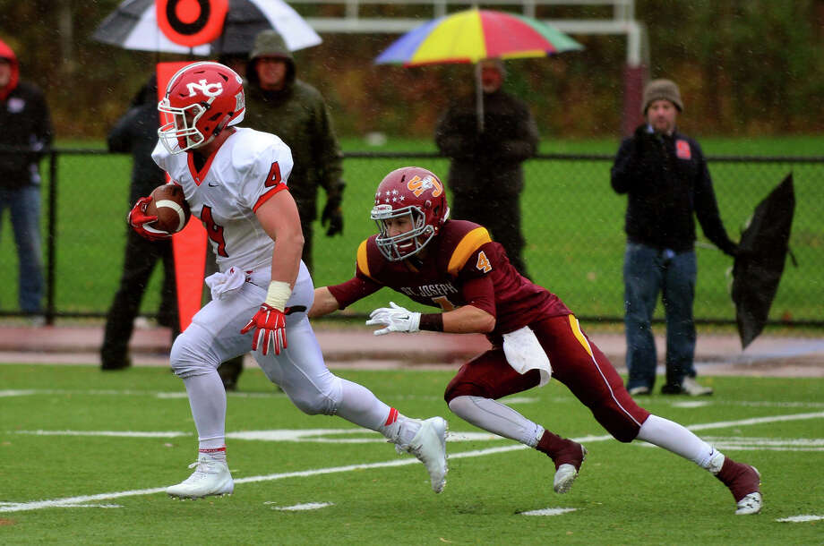 Football action between new Canaan and St. Joseph in Trumbull, Conn. on Saturday, November 1, 2014. Photo: Christian Abraham / Connecticut Post