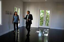 Realtor Joel Goodrich (right) shows Sara Ledterman (left) a home for sale in St. Francis Wood in San Francisco, Calif., on Thursday, October 2, 2014.
