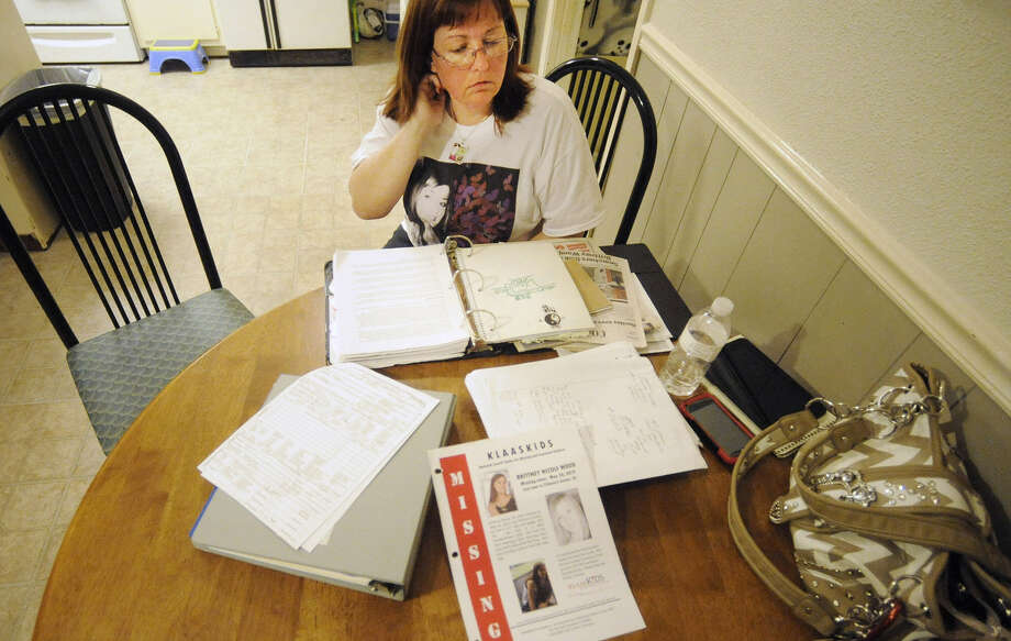 Stephanie Hanke, Brittney Wood's stepmother, looks over materials at her home related to the search for the teen. Wood is presumed dead, but authorities haven't found a trace of her. Photo: Jay Reeves / Associated Press / AP