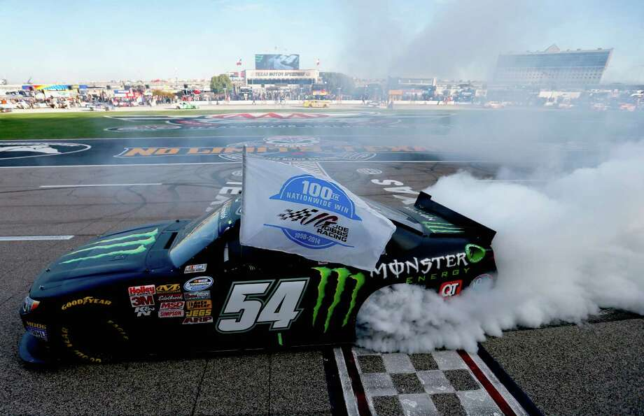 FORT WORTH, TX - NOVEMBER 01:  Kyle Busch, driver of the #54 Monster Energy Toyota, celebrates with a burnout after winning the NASCAR Nationwide Series O'Reilly Auto Parts Challenge at Texas Motor Speedway on November 1, 2014 in Fort Worth, Texas.  (Photo by Sean Gardner/Getty Images for Texas Motor Speedway) ORG XMIT: 521042619 Photo: Sean Gardner / 2014 Getty Images