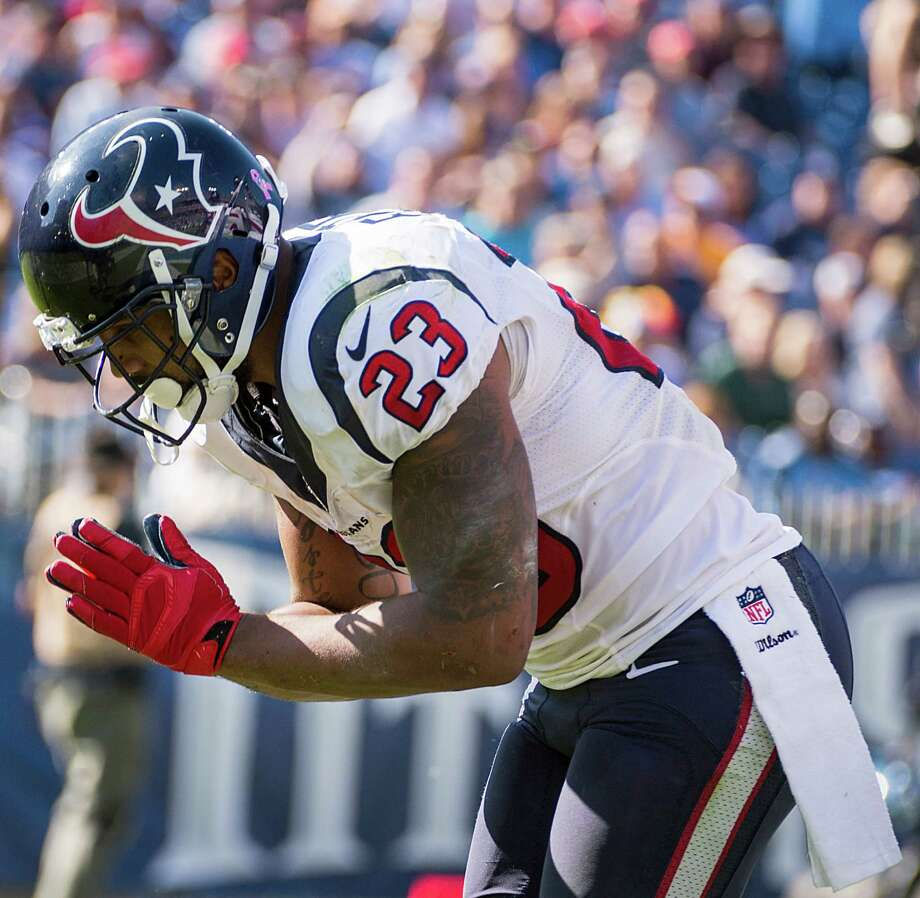 Taking a bow has become Arian Foster's end-zone ritual each time he scores. At his current rate - nine touchdowns (seven rushing, two receiving) in eight games this year -  the Texans running back may need salve for a sore back by season's end. Photo: Smiley N. Pool, Staff / © 2014  Houston Chronicle