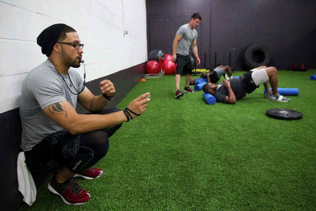 Through his IX Innovations gym in Houston, Abdul Foster, left, helps condition several Texans players, including foremost his younger brother Arian.