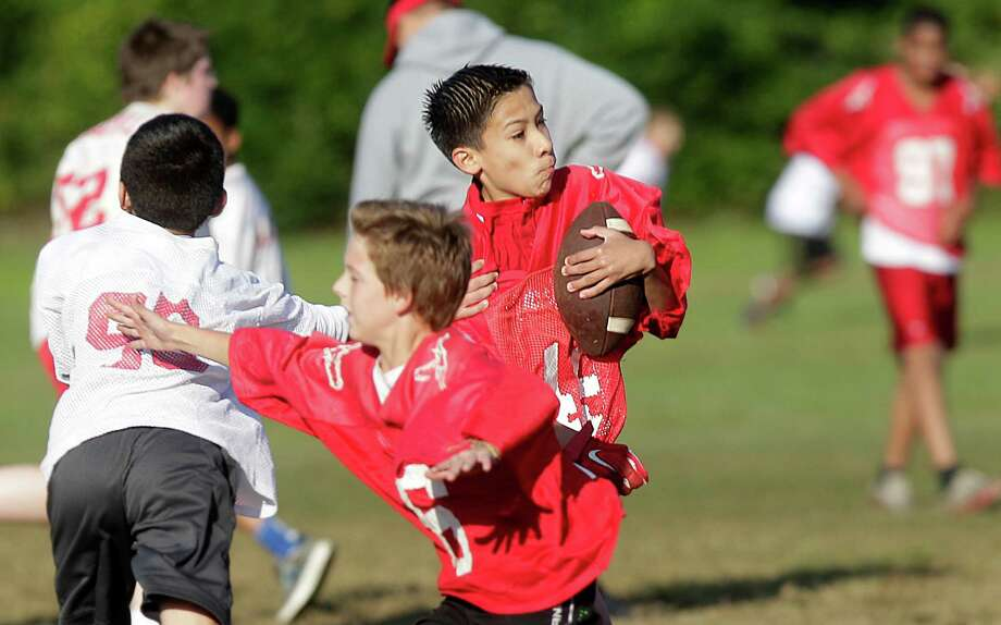 Competition is intense even though Marshall Junior High has adopted touch over tackle football for seventh-graders. Photo: Mayra Beltran, Staff / © 2014 Houston Chronicle