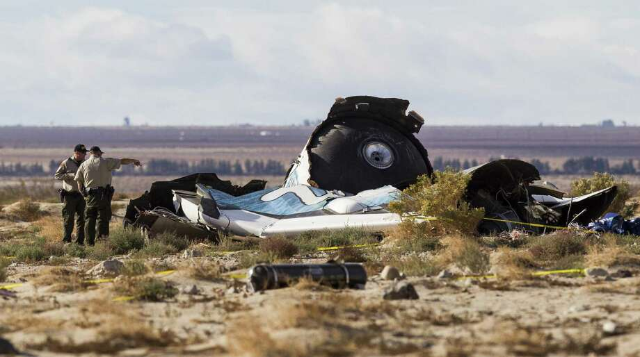 Officers investigate the wreckage of the Virgin Galactic space tourism rocket, SpaceShipTwo on Saturday. The spaceship exploded and crashed into the Mojave Desert in California. Photo: Ringo H.W. Chin / Associated Press / FR170512 AP