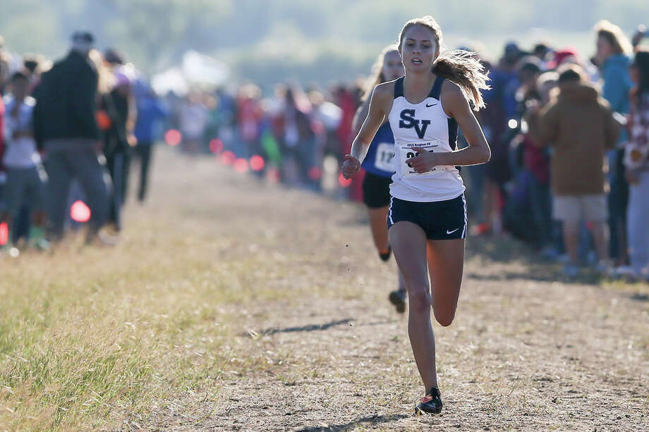 Smithson Valley's Devin Clark leads New Braunfels' Paige Hofstead as they approach the finish line of the 6A Girls 5K during the Region IV Cross Country Championships at the National Shooting Complex on Saturday, Nov. 1, 2014. Clark won the event with a time of 17 minutes, 17.1 seconds while Hofstead was second with 17 minutes, 19.9 seconds. MARVIN PFEIFFER/ mpfeiffer@express-news.net Photo: MARVIN PFEIFFER, STAFF / Marvin Pfeiffer/ Express-News / Express-News 2014