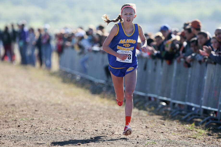 Alamo Heights' Abby Gray approaches the finish line of the 5A Girls 5K during the Region IV Cross Country Championships at the National Shooting Complex on Nov. 1, 2014. Photo: Marvin Pfeiffer /San Antonio Express-News / Express-News 2014