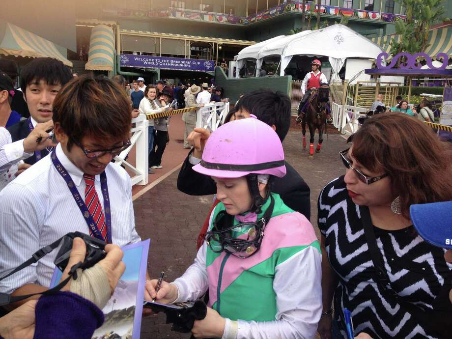 A day after telling the world she was going to retire as a jockey because she is pregnant, Rosie Napravnik was back at Santa Anita riding in the Breeders' Cup. After this weekend, she is off to motherhood. She is still quite the fan favorite. After finishing second in the Breeders' Cup Juvenile Fillies, Rosie stopped and signed autographs on her way back to the jockey's room. She probably could have stayed there all day, she was that much in demand.  —Tim Wilkin