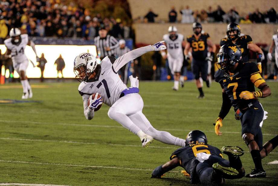 TCU's Kolby Listenbee is tripped up on the 40-yard reception that set up the Horned Frogs' winning field goal. Photo: Tyler Evert, FRE / FR170609 AP